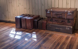 Old Vintage Suitcase in the room Stock Images