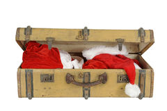 Old vintage suitcase with santa clothes, Stock Photo