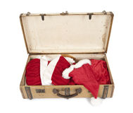Old vintage suitcase with santa clothes Royalty Free Stock Images