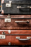 Old vintage suitcases. Pyramid of the three vintage old suitcases Royalty Free Stock Image