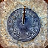 Old Vintage Sundial Set in Concrete. Sundial Set in Concrete with Quotation Grow Old Along with Me the Best Is Yet to Be stock photography