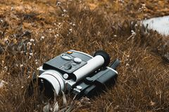 Old Vintage Super 8 Film Camera Lying on Dead Grass royalty free stock images