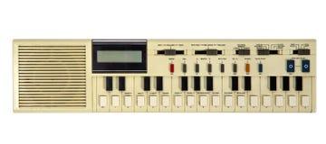 Old vintage synthesizer. Isolated on white stock photo