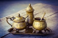 Old vintage tableware from bronze Royalty Free Stock Images