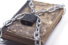 Old vintage tattered book lock with chain white background Royalty Free Stock Photography