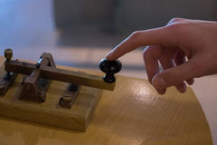 The old and vintage telegraph key and operator's hand , Morse sy Royalty Free Stock Images