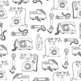 Old vintage telephone background. Vector seamless pattern of retro phones. Repeat backdrop of black telephones isolated on white royalty free illustration