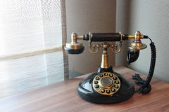 Old vintage telephone on a desk Royalty Free Stock Images