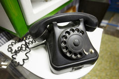 Old vintage telephone with rotary dial numbers Royalty Free Stock Photos