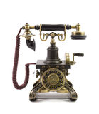 Old vintage telephone. On the white background Royalty Free Stock Image