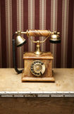 An old vintage telephone on a wooden table Royalty Free Stock Image