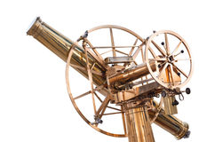 Old vintage telescope isolated on white. Old large vintage shining brass telescope isolated on white Royalty Free Stock Photos