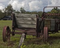 Old Vintage Thresher in front of Abandoned barn stock photography