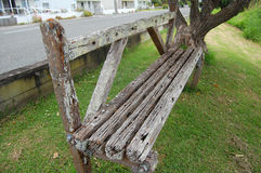 Old vintage timber bench in town park Stock Photo