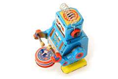 Old vintage tin robot with drum. And sticks on white background stock illustration