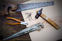 Old vintage tools of the carpenter on wood table Stock Photography