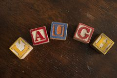 Old Vintage Toy Block Letters spell word Laugh stock image