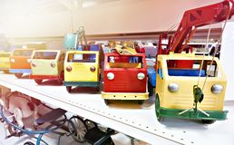 Old vintage toy trucks in store. Old vintage toy trucks in the store royalty free stock photos