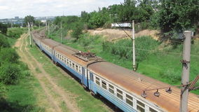 Old vintage train approaches  with six railway carriages - front view from above stock footage