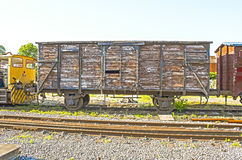 An old vintage  train wagon on the rails Royalty Free Stock Photo