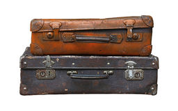 Old vintage travel suitcases isolated on white Royalty Free Stock Image