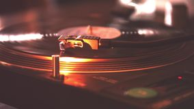 Old and vintage turntable for DJ. Old turntable for vintage DJ playing a record inside a disco stock video footage