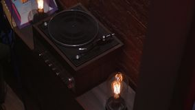 The Old Vintage Turntable. Vinyl records player tungsten lamp stock video