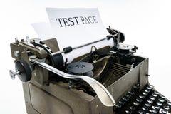 Old vintage typewriter with blank paper sheet Stock Photos