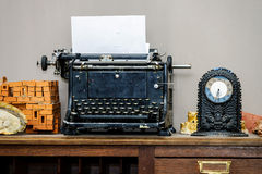Old vintage typewriter with blank paper sheet Stock Image
