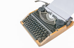 Old vintage typewriter with a blank sheet of paper inserted Royalty Free Stock Photos