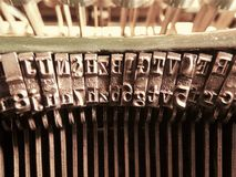 Old vintage typewriter metal letters close up. Old vintage typewriter letters macro close up picture Royalty Free Stock Photography