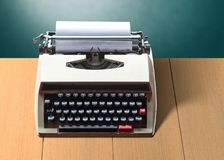 Old vintage typewriter with white blank paper Stock Images