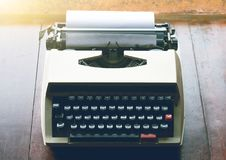 Old vintage typewriter with white blank paper Stock Photos
