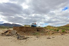 Old vintage van on damaged and washed out road in Baja California, Mexico. Old vintage van on damaged, flooded and washed out road in Baja California, Mexico Royalty Free Stock Image