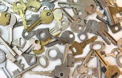 Old vintage various keys pattern. Antique metal gold bronze silver color different clue for padlock. Chaotically mix. Flat lay top view composition royalty free stock photography
