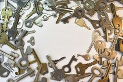 Old vintage various keys pattern. Antique metal gold bronze silver color different clue for padlock. Chaotically mix. Flat lay top view round composition royalty free stock photo