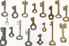 Old vintage various keys pattern. Antique metal gold bronze silver color different clue for padlock. Set flat lay top. View composition stock images