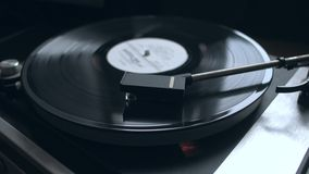 Old vintage vinyl playing music. Old vintage good looking turntable playing a track with vinyl. 4k Uhd. Cinematic footage stock video