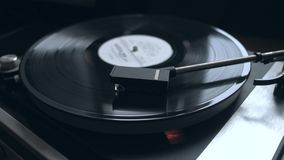 Old vintage vinyl playing music. Old vintage good looking turntable playing a track with vinyl. 4k Uhd. Cinematic footage. Timelapse stock footage