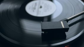 Old vintage vinyl playing music. Old vintage good looking turntable playing a track with vinyl. 4k Uhd. Close-up. Cinematic footage stock video