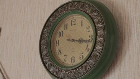 Old vintage wall clock in country house, Belarus. Parallax view stock footage