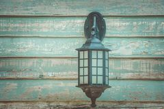 Old vintage wall lamp on wooden wall in vintage style. stock photos