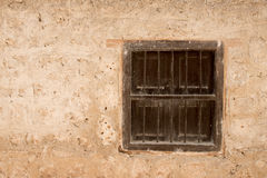 Old vintage wall with wooden window. Royalty Free Stock Image