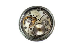 Old vintage watch mechanism. Rusty oil dirt on circle gears before cleaning and refining. Required watch service repair royalty free stock photos