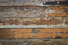 Old vintage weathered wood wall texture background. Old weathered vintage wood background peeling off brown color Stock Image