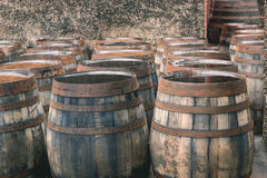 Old vintage whisky barrels filled of whiskey placed in order in Royalty Free Stock Image