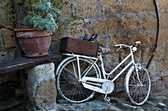 Old vintage white bicycle in Italy. royalty free stock image