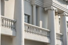 Old vintage white building with columns, facade royalty free stock image