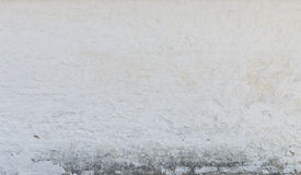 Old vintage white stucco wall with cracks as background. Texture Stock Photo