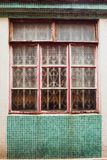 Old vintage window of house old fashion design classic on green rustic mosaic on concrete wall background stock image